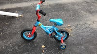 toddler's blue and red bicycle St Catharines, L2N 7R3