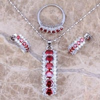 silver-colored red gemstone pendant necklace