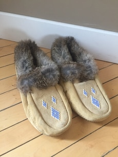 Pair of brown and gray slip ons moccasins