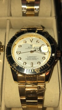 round silver-colored Rolex analog watch with link bracelet 551 km