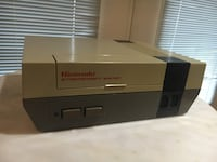 Gray and black nes console Fayetteville, 72701
