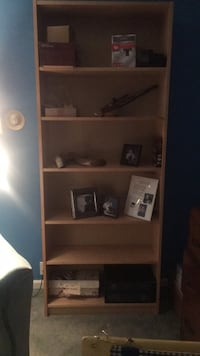 Brown wooden book case with 6 shelves. 6 feet y'all, 18 inches deep South Orange, 07079