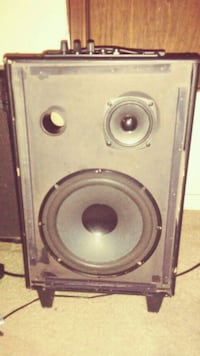 brown and gray subwoofer speaker