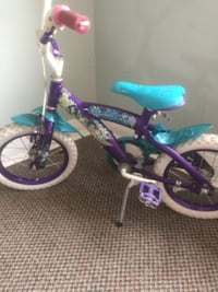 toddler's purple and teal bicycle London