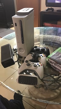 White Xbox 360 premium with there controllers and one chatpad Toronto, M5V 0E4