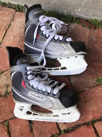 Pair of black-and-gray Bauer ice skates; youth (men's size 4.5) 920 mi
