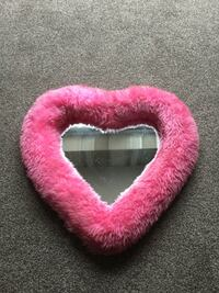 Pink fluffy heart shaped mirror . 5772 km