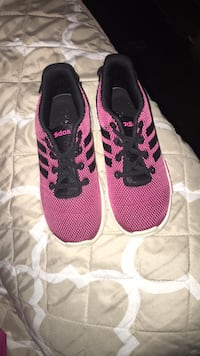 pair of pink-and-black Nike running shoes Enfield, 27823
