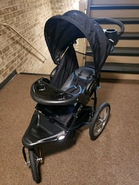 baby's black and gray jogging stroller 27 km