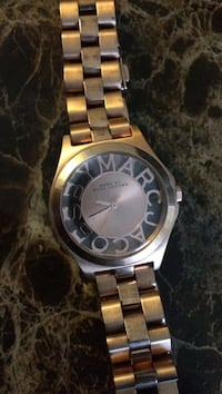 Round gold Rolex analog watch with link bracelet