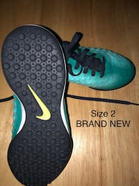 pair of green Nike basketball shoes