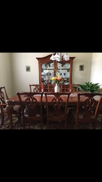 Dinning Room set. 8 Chairs Set. China and Large table with extra protection. Excellent condition. Lake Mary, 32746