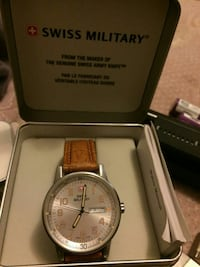 Authentic swias army watfh in box with papers warr