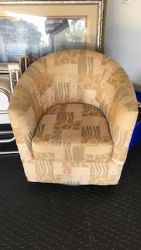 Beige and tan & gold swivel chair good condition