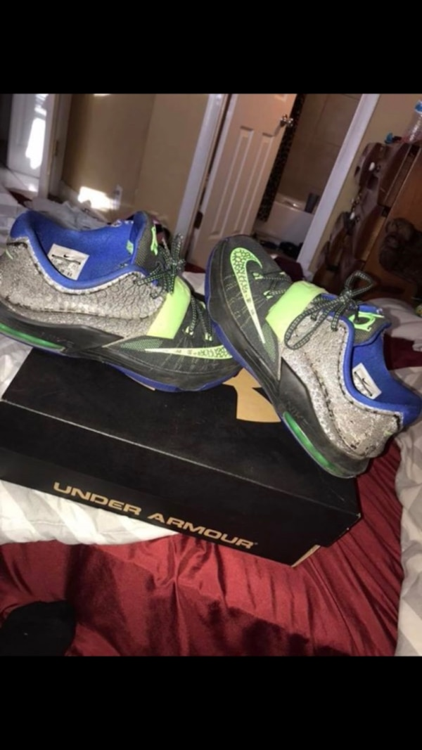 pair of black-and-gray Nike Kevin Durant basketball shoes