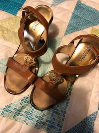 pair of brown-and-grey leather open-toe ankle strap heels