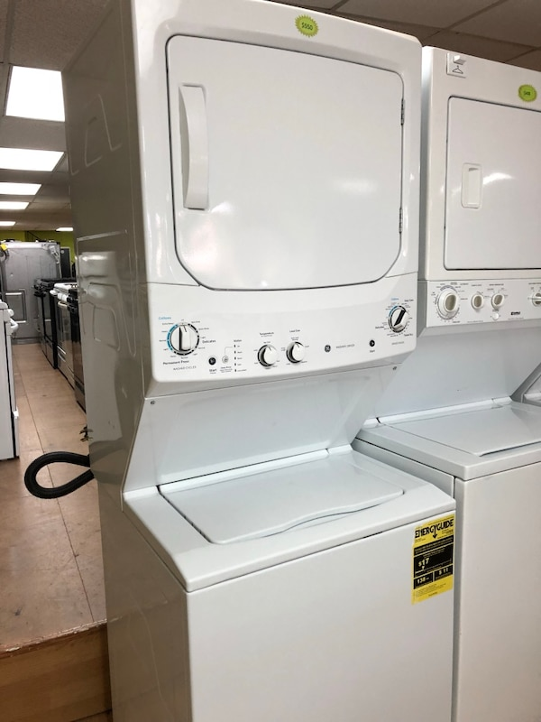 """GE white stacked washer and dryer unit 27"""""""