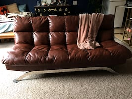Couch/futon with ottoman and pillows