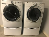 two white front-load washing machines