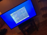 black flat screen TV with remote Lake Charles, 70607