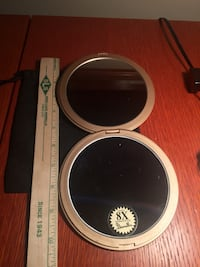 Gold steel round mirror magnification 8X excellent for make up. Calgary, T2Z 3R3
