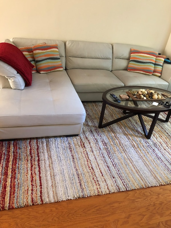 Living room sectional with accent chair. Pillows, coffee table, side table  and area rug included!