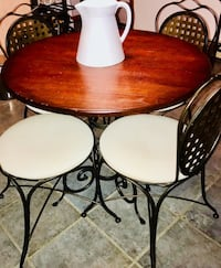 Solid wrought iron and walnut wood bistro table with 4 chairs! Walpole, 02081