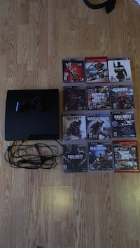 Black Sony PS3 slim with controller and 12 games Dartmouth, B2W 4E1