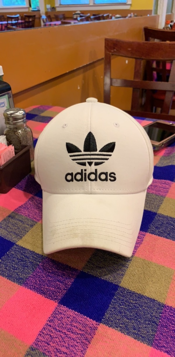 white and black Adidas fitted cap