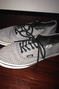 pair of gray-and-white Vans low top shoes