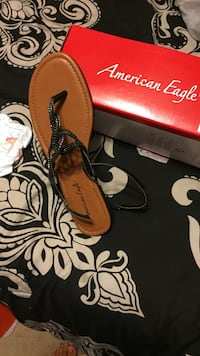 brown and black leather American Eagle sandal