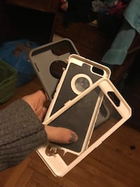 three white and black life proof iPhone case