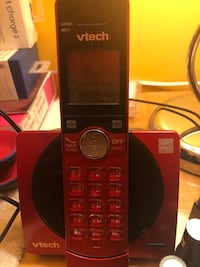 Red Vtech cordless phone