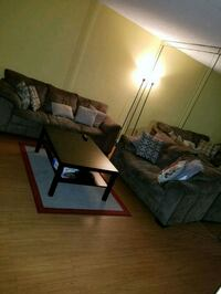 Brown couches and wooden black coffee table Miami Lakes, 33016