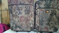 two beige floral soft-side luggages