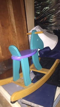 blue purple and brown wooden rocking horse 49 km