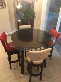 Round brown wooden table with four chairs dining set Land O Lakes, 34638