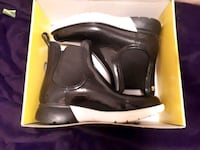 pair of black leather boots Dartmouth, B3A 1W4