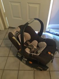 baby's gray and black Chicco booster seat