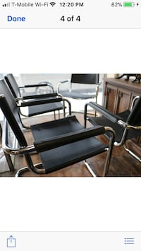 grey metal framed black pad armchair set screenshot