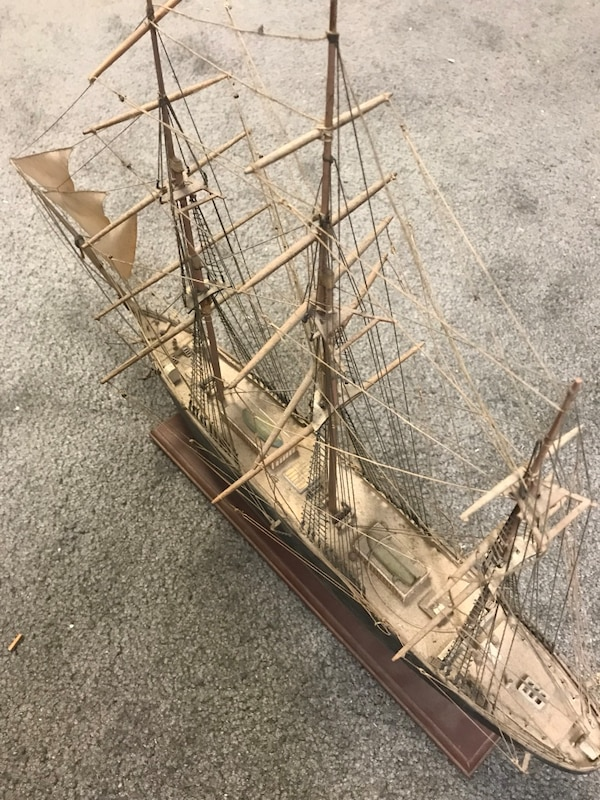 "Old wooden ship model, hand built. Beautiful model about 2 feet long from early 80's it is 16 1/2"" tall from bottom of base to top or mast and about 26"" long"