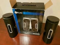 two cylindrical black portable speakers with box Mississauga, L5M 5L6