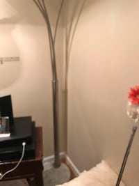 Stainless steel and marble 6 1/2 ft lamp. NEED GONE