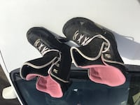 black-and-pink snowboard boots