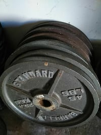 grey weight plates lot fitness equipment