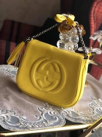 yellow leather crossbody bag with gold-colored chain Clinton Twp, 48038