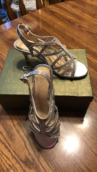 Silver sequins sandals worn for 2 hours very pretty & comfortable.$15.00, size 7 Blaine, 55434