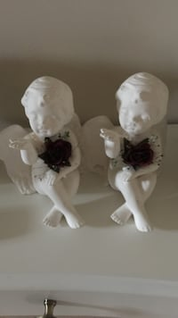 two white ceramic angel figurines