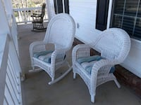 white wicker rocking chair and armchair