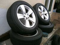 4 Stock Jeep wheels with good threaded tires